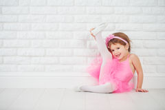 Little girl dancer ballet ballerina stretching stock images