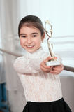 Girl dancer shows Cup win Stock Photography