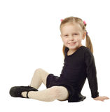 Little Girl dancer sits on White Background Royalty Free Stock Image
