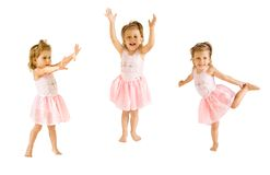 The little girl dances. The little girl in a suit of the ballerina dances on a white background royalty free stock photography