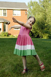 Little girl dances Royalty Free Stock Image