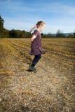 Little girl dances Royalty Free Stock Image