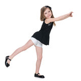 Little girl dances on the white background Stock Photo