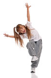 Little girl dancing. Happy little girl dancing isolated on white background royalty free stock images