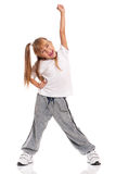 Little girl dancing. Happy little girl dancing isolated on white background royalty free stock image