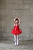 Little girl dancing. In a red tutu Royalty Free Stock Photos