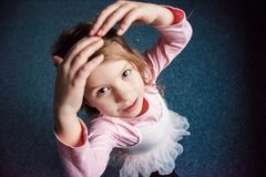 Little girl dancing in ballet dress royalty free stock images