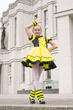 Little girl dancing in bee costume Stock Photos