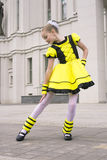 Little girl dancing in bee costume Stock Images