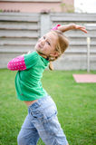 Little girl dancing Stock Images