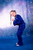 Little girl dancing in the blue costume Stock Images