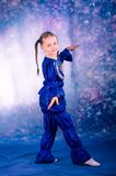 Little girl dancing in the blue costume Royalty Free Stock Image