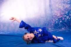 Little girl dancing in the blue costume Royalty Free Stock Photo