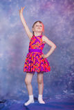 Little girl dancing in colourfull costume Stock Photo