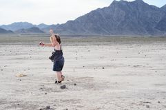 Little girl dancing in desert Stock Images