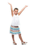 Little girl dancing hands up Stock Photo