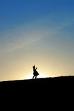 Little girl dancing on hill Royalty Free Stock Photos
