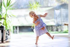 Little girl dancing indoors Stock Images
