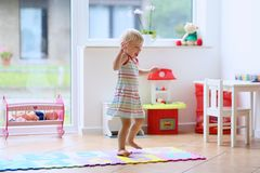Little girl dancing indoors stock photos