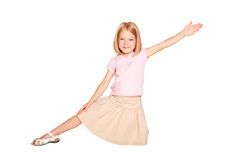 Little girl dancing. Isolated on white Stock Photo