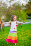 Little girl dancing in the park Stock Images