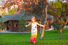 Little girl dancing in the park Royalty Free Stock Photo