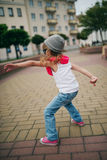 Little girl dancing on the street Royalty Free Stock Photography
