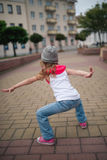Little girl dancing on the street Royalty Free Stock Image