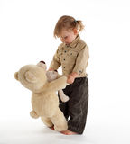 Little girl dancing with teddybears Stock Image