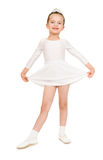 Little girl dancing in a white ball gown Royalty Free Stock Image