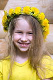 Little girl in dandelion crown royalty free stock image