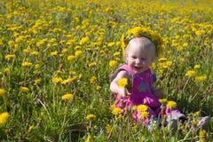 Little girl with dandelion diadem stock photography