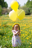 Little girl on dandelion field Stock Images
