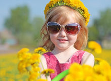 Little girl with dandelions Royalty Free Stock Image