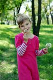 Little girl with dandelions Stock Photography