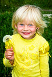 Little girl with dandelions Stock Photo