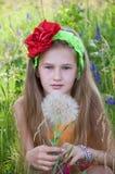 Little girl with dandellion. Little beautiful girl with dandellion Stock Photos
