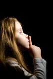Little girl in the darkness. Requests silence Stock Photos
