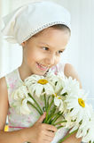 Little girl with dasies flowers Stock Images