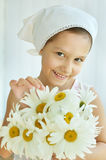 Little girl with dasies flowers Royalty Free Stock Image