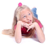 Little girl day dreaming Stock Images
