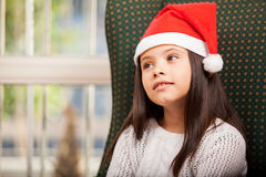 Little girl daydreaming at home Royalty Free Stock Image