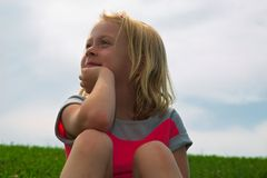 Little Girl Daydreaming stock photo