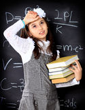 The little girl decides to mathematical Royalty Free Stock Photo