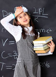 The little girl decides to mathematical Royalty Free Stock Photography