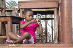 Little Girl on Deck with Mobile Phone Stock Photos