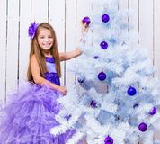 Little girl decorated Christmas tree Stock Photos