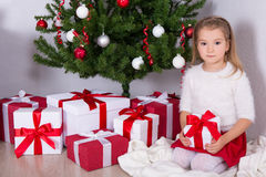 Little girl with decorated Christmas tree at home Royalty Free Stock Photography