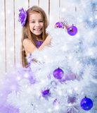 Little girl decorated Christmas tree Stock Photo