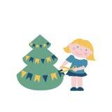 Little girl decorates Christmas tree Royalty Free Stock Photos